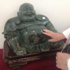 Rubbing the tummy of a jade Buddha