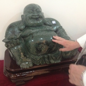 Rubbing the tummy of a jade Buddha