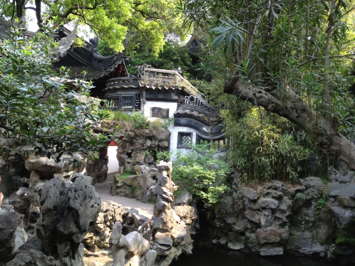 A Chinese garden has four elements: water, rocks, plants, and structures