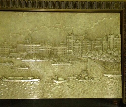One of four reliefs on the hotel lobby walls