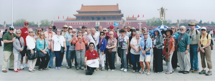 Our tour group in Tianenmen Square, with the iconic entrance to the Forbidden City, adorned with Mao's picture, in background.