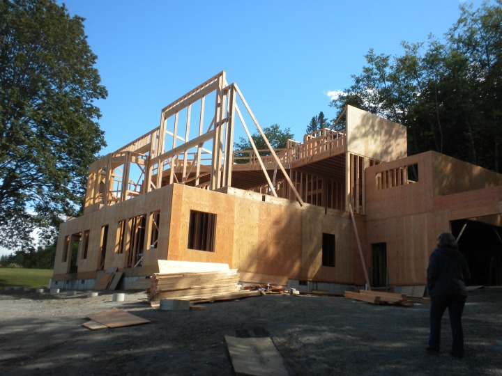 The house with framing in for the front living-room windows and the loft