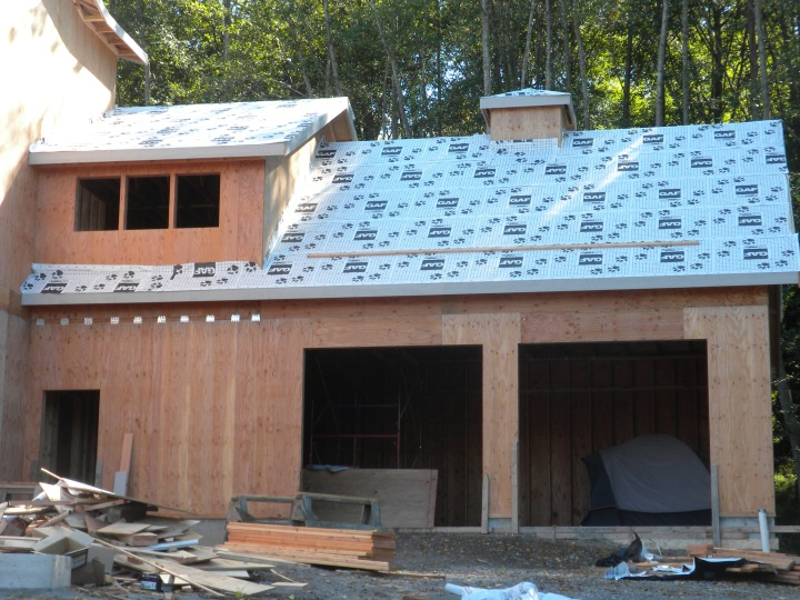 The garage with the first layer of roofing material and with the cupola added. The roof will be metal.