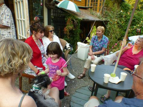 Cliff and Heather's party, with their new dog Dougal and 5-year-old granddaughter Lulu in the foreground