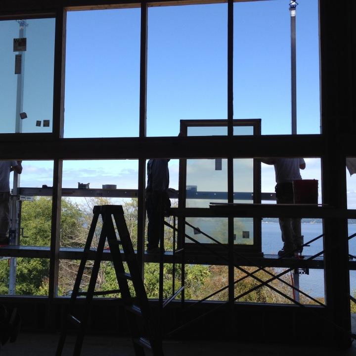 Workmen installing the living-room windows