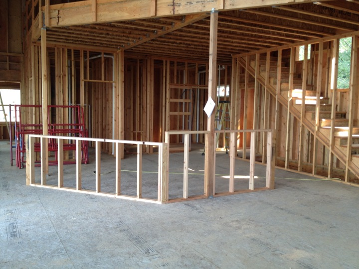 Framing for the kitchen counter and bar, where the sink and cooktop will go