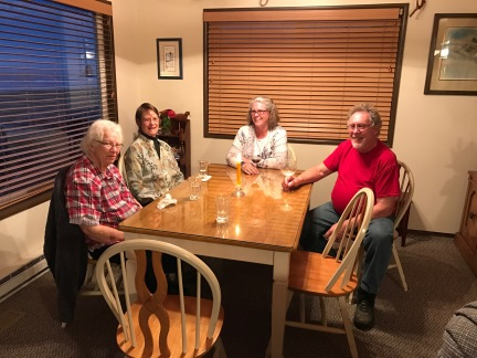 Gathered around the table: Lois, Karen, Robin, Mark