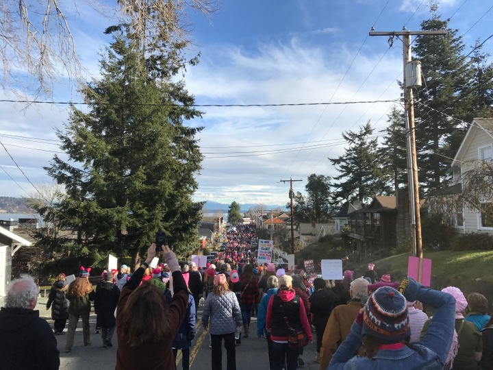 The women's march passes through downtown Langley.