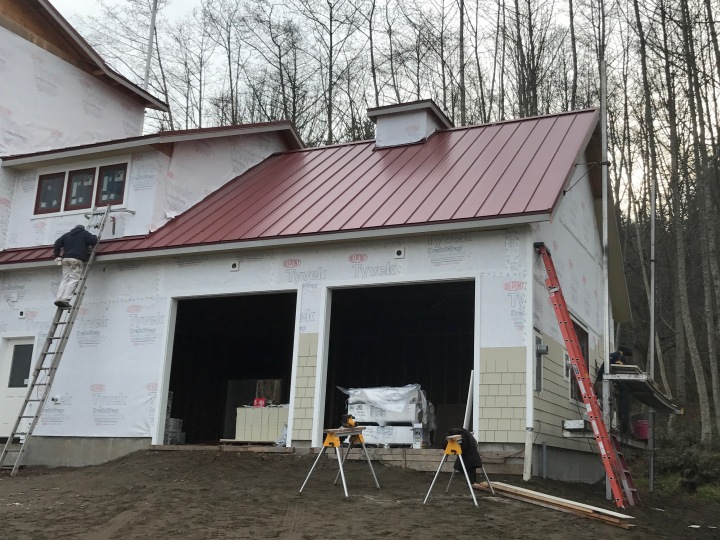 Siding now going on the end and the front of the garage.