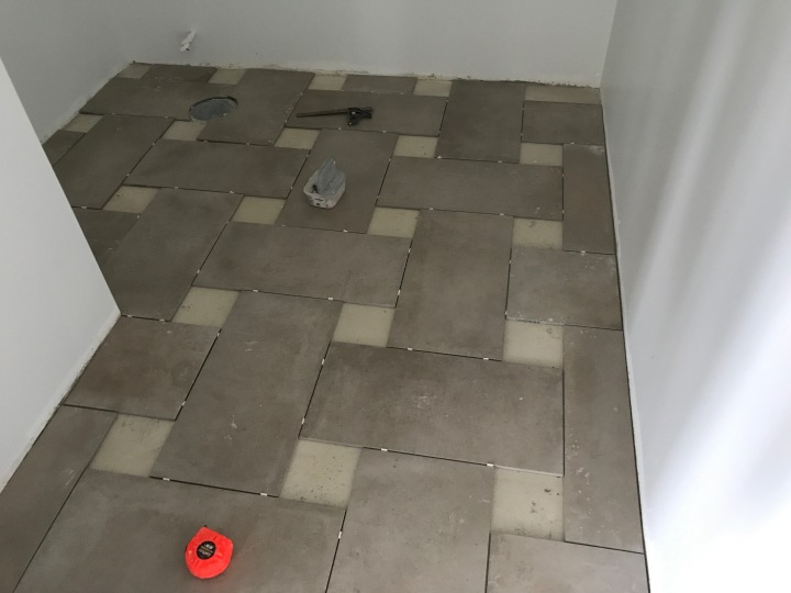 Tile on the floor in the powder room. Still to be added: decorative tiles made by a local tile-maker.
