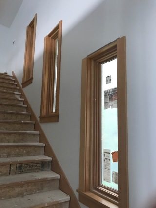 Stairway windows with trim partly in place