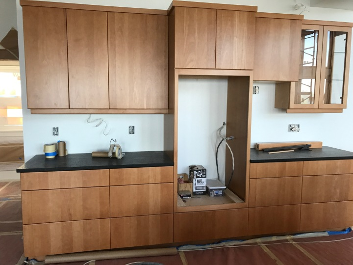 Kitchen cabinets with counter in place. Counters are leathered granite.