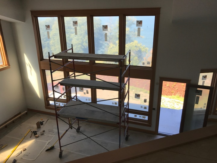 Living-room windows with all the trim in place. They'll look better when the scaffolding is removed.