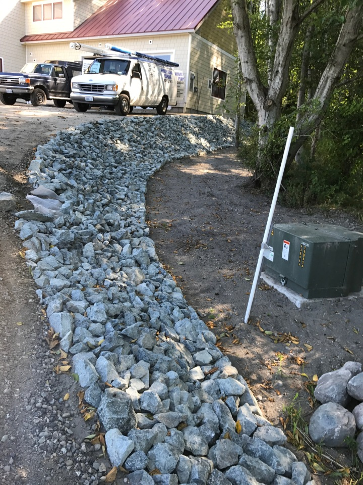 Rock border on slope along the driveway