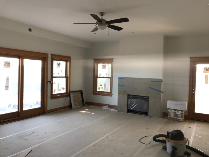 Master bedroom, with ceiling fan/light and fireplace surround in place