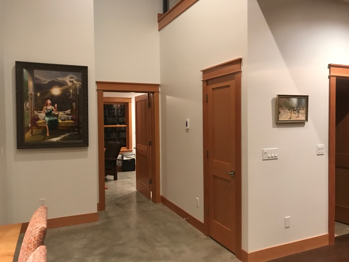 Two of the paintings that Rob Schouten helped us hang. The large one is by Rob; the small one, by my sister Nancy.