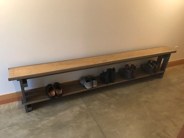 The bench in the first-floor hall, complete with boots.