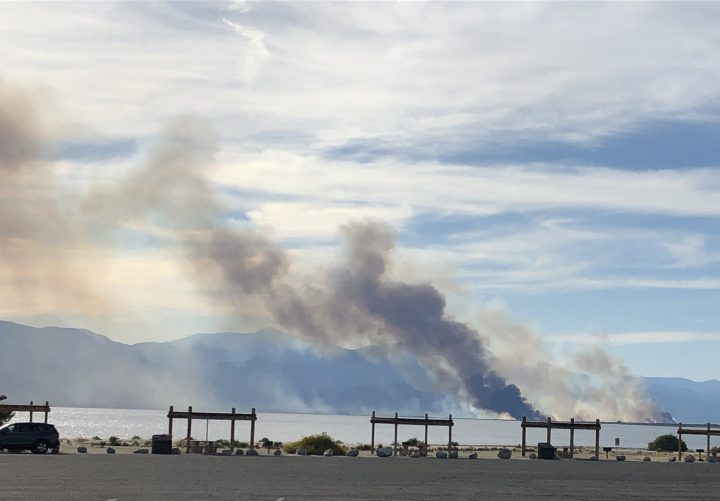 Smoke from a fire rising over the Salton Sea
