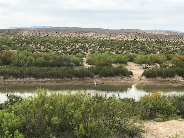 "The Rio Grande, with a couple of canoes waiting no doubt to make an ""illegal crossing."""
