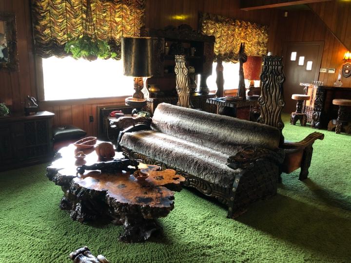 "The ""jungle room."" com plate with green shag carpet"