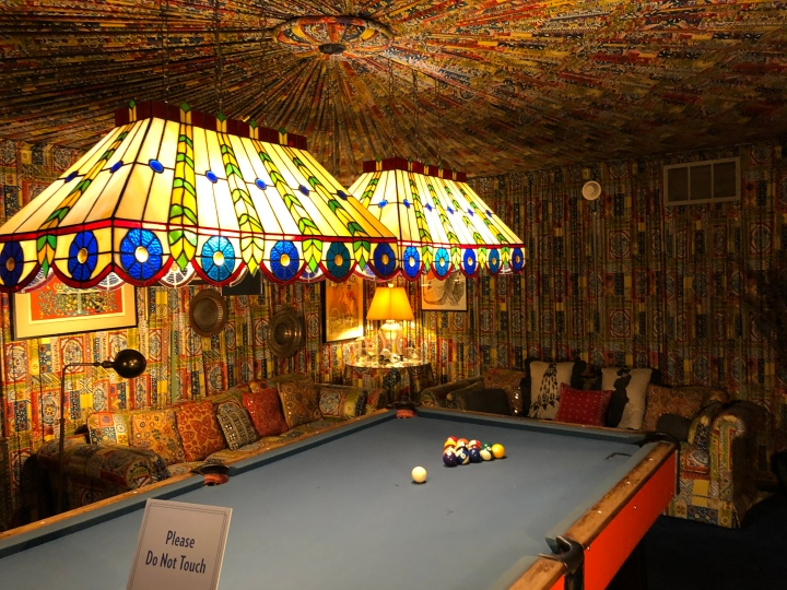 The billiard room, with fabric on the walls and ceiling
